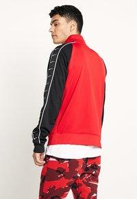 Nike Sportswear - Training jacket - university red/black - 2