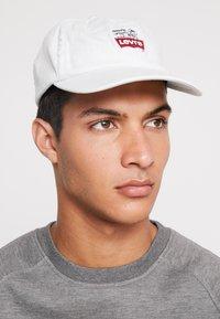 Levi's® - PEANUTS LEVI'S® FLEXFIT HAT - Cap - light blue - 1