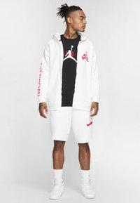 Jordan - JORDAN AIR WORDMARK MEN'S T-SHIRT - Print T-shirt - black/infrared 23 - 1