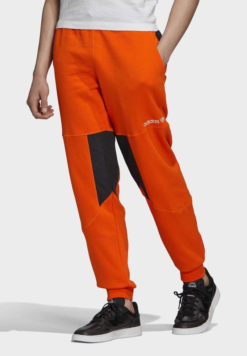adidas Originals - ADVENTURE FIELD JOGGERS - Tracksuit bottoms - orange