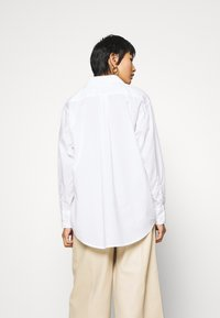 TOM TAILOR - BLOUSE SOLID LOOSE SHAPE - Button-down blouse - white - 2