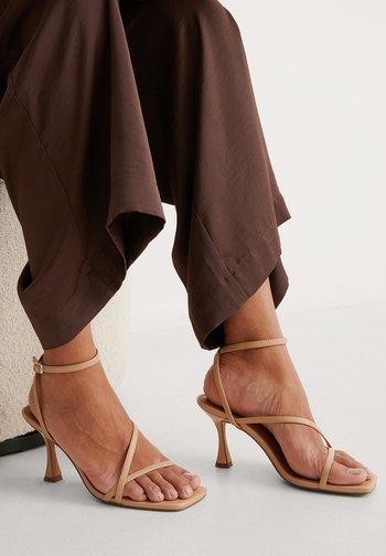 HOURGLASS - High heeled sandals - beige