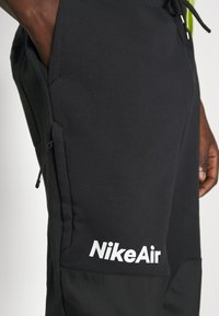 Nike Sportswear - AIR PANT  - Tracksuit bottoms - black/white - 4