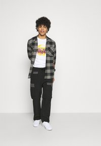 Levi's® - ZIP OFF - Cargobyxor - blacks - 1