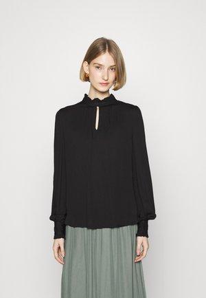 BAUMA TINIA SHIRT - Bluse - black