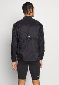 Diadora - LIGHTWEIGHT WIND JACKET BE ONE - Sports jacket - black - 2