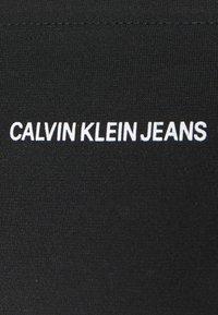 Calvin Klein Jeans - MILANO BARDOT - Print T-shirt - black - 2