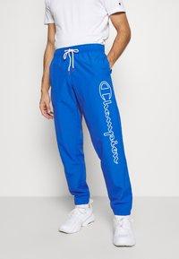 Champion - ELASTIC CUFF PANTS - Tracksuit bottoms - blue - 0