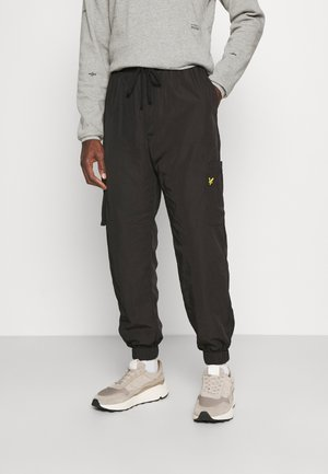 TECH POCKET TRACKPANT - Cargo trousers - jet black