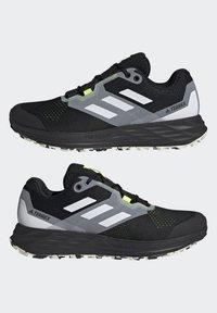adidas Performance - TERREX TWO FLOW - Stabilty running shoes - savannah/core black/hi-res yellow - 4