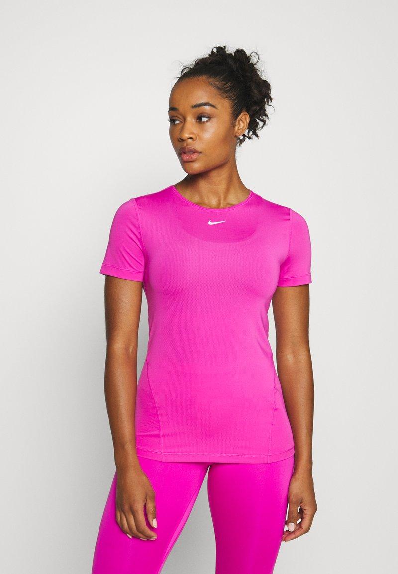 Nike Performance - ALL OVER - T-shirt - bas - active fuchsia/white