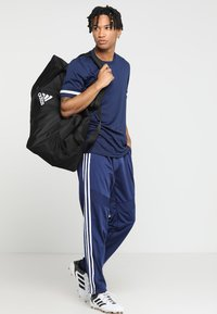 adidas Performance - TIRO - Spodnie treningowe - darkblue/white - 1