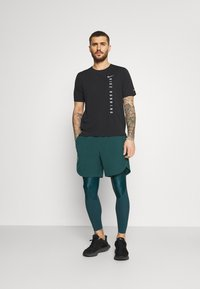 Under Armour - SHORTS - Sports shorts - dark cyan - 1