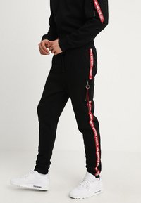 Alpha Industries - JOGGER TAPE - Tracksuit bottoms - black - 0