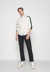 Polo Ralph Lauren - LOOPBACK - Sweatshirt - chic cream/college green - 1