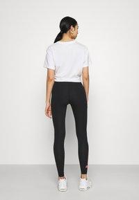 Nike Sportswear - CLUB - Leggings - black/hyper pink - 2