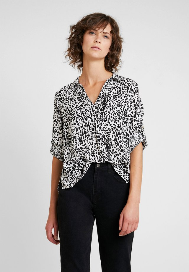 PRINTED BLOUSE - Blouse - several
