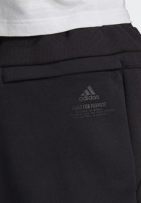 adidas Performance - Z.N.E. SPORTSWEAR PRIMEGREEN PANTS - Tracksuit bottoms - black - 7