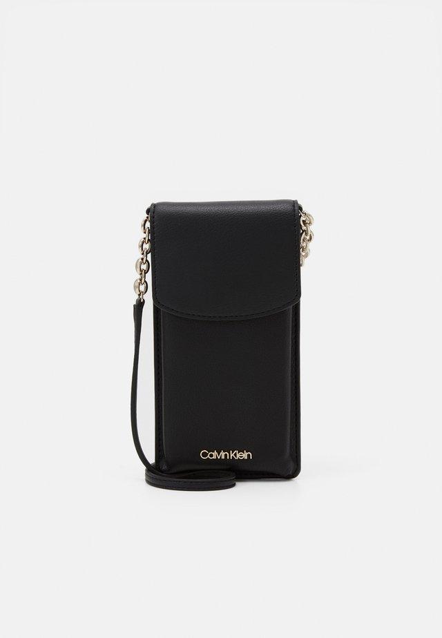 PHONE POUCH CROSSBODY - Across body bag - black