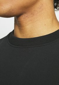 adidas Originals - BASICS CREWNECK UNISEX - Sweatshirt - black - 4