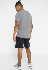 Under Armour - Sports shirt - charcoal light heather/black - 2