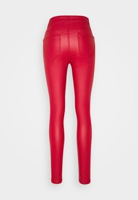 Noisy May - NMCALLIE SKINNY COATED PANTS - Trousers - haute red - 1