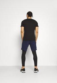 Puma - SEAMLESS BODYWEAR LONG - Collants - black - 4