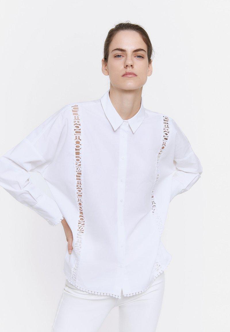 Uterqüe - Button-down blouse - white