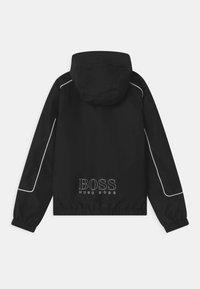 BOSS Kidswear - WINDBREAKER - Light jacket - black - 1