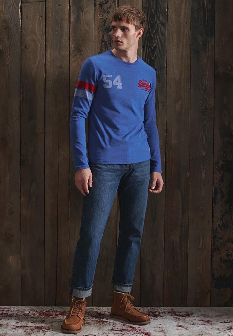 Superdry - VINTAGE LOGO VARSITY - Long sleeved top - mazarine blue marl