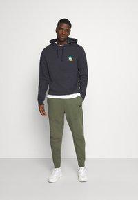 Nike Sportswear - Tracksuit bottoms - twilight marsh - 1