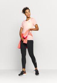 adidas Performance - ADI RUNNER TEE - Print T-shirt - coral - 1