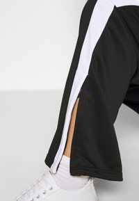 Fila Plus - SAMAH TRACK PANT - Verryttelyhousut - black/bright white - 3