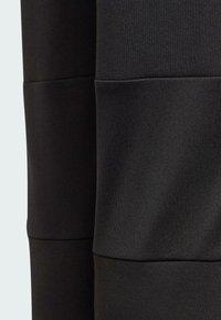adidas Performance - X LEGO TRAINING WORKOUT - Pantalon de survêtement - black - 4