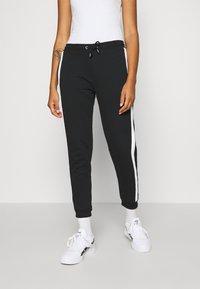 Even&Odd - Spodnie treningowe - black/white - 0