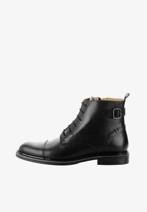 PETRANA - Lace-up ankle boots - black