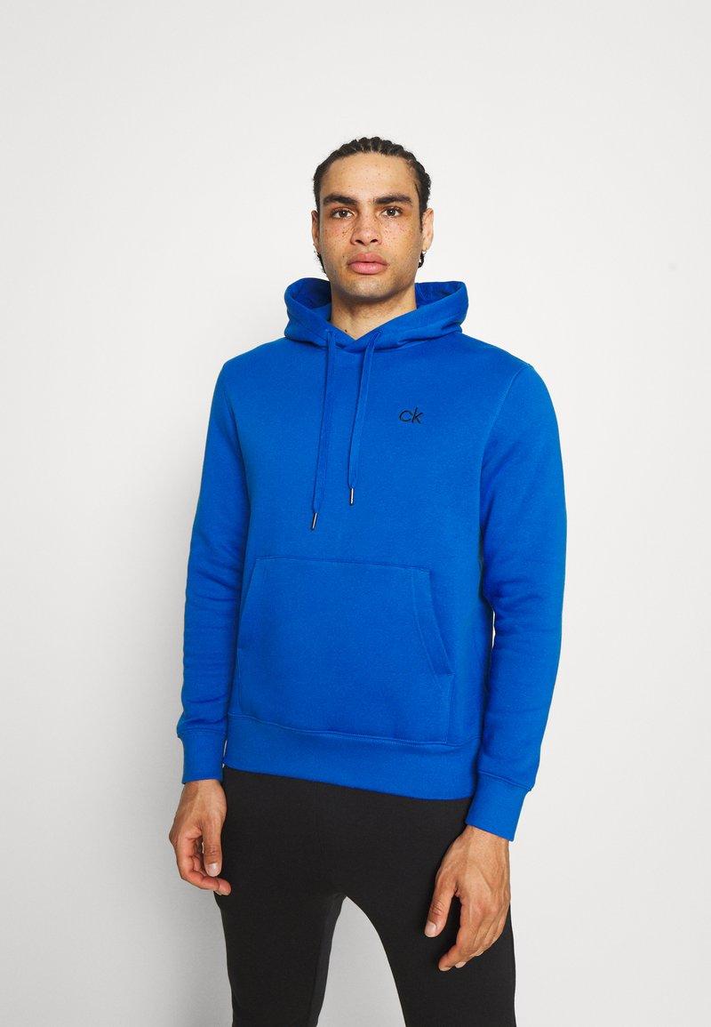 Calvin Klein Golf - PLANET HOODIE - Sweatshirt - nautical blue
