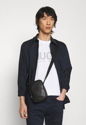 ROCKET ZIP UNISEX - Across body bag - black