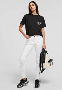 KARL LAGERFELD - Trousers - white denim - 1