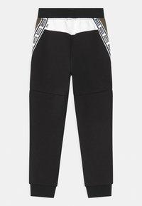 BOSS Kidswear - Tracksuit bottoms - black - 1