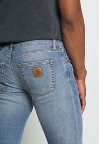 Carhartt WIP - REBEL PANT SPICER - Slim fit jeans - blue mid used wash - 4