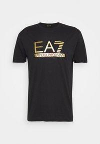 Print T-shirt - black/gold