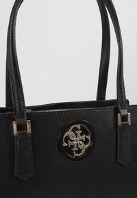 Guess - OPEN ROAD LUXURY SATCHEL - Handbag - black - 2