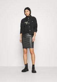 Calvin Klein Jeans - COATED MILANO SKIRT - Pencil skirt - black - 1