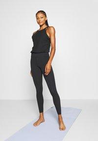 Nike Performance - YOGA JUMPSUIT - Turnanzug - black/dark smoke grey - 0