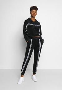 adidas Originals - CUFFED PANTS - Joggebukse - black - 1