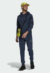 adidas Originals - FI Graphic PO BD MUST HAVES SPORTS RELAXED SWEATSHIRT HOODIE - Luvtröja - blue - 1