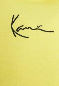Karl Kani - SIGNATURE WASHED HOODIE UNISEX - Sweatshirt - light yellow - 5