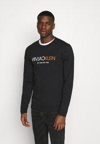 Calvin Klein - Longsleeve - black - 0