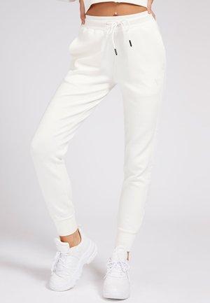 Pantalon de survêtement - weiß